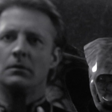 Black-and-white screencap from Babylon 5 featuring Captain Sheridan being spoken to by a piece of an ancient guardian species inside his head.